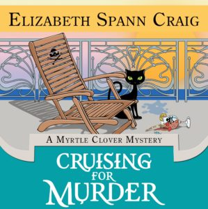 Cover of Cruising for Murder shows a black cat on the deck of a cruise ship next to a deck chair with a skull and crossbones on it.