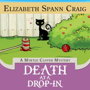 Cover features a black cat near a bloody croquet mallet and ball.