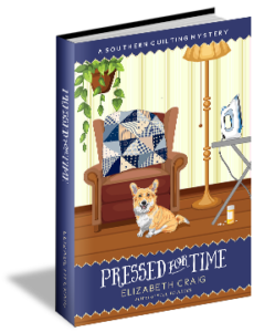 "A corgi sits placidly in a living room with an ironing board off to the side. Under the ironing board is a menacing looking pill bottle and the book's title ""Pressed for Time"" by Elizabeth Craig underneath."