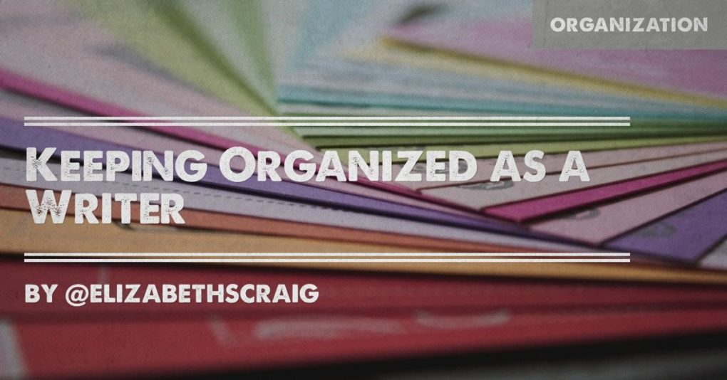 Colorful paper and folders are in the background and the post title, 'Keeping Organized as a Writer' is superimposed on the top.