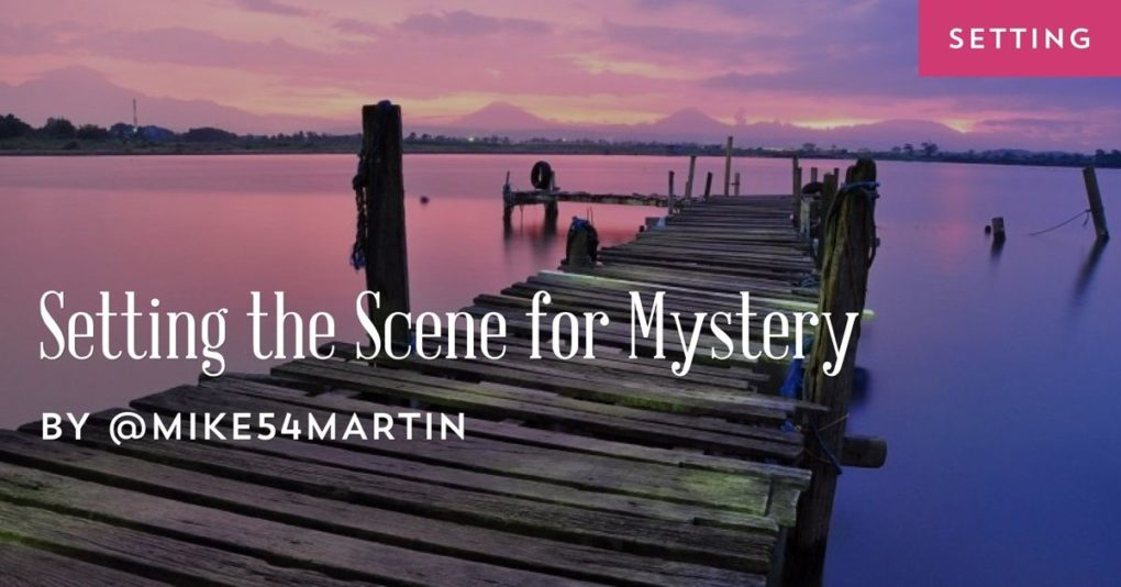 "A wooden dock leads off to some sunset-illuminated water and the post title, ""Setting the Scene for Mystery"" is superimposed on the top."