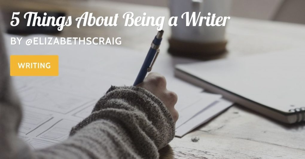 "A woman's hand is holding a pen as she writes on a notebook on a writing table. The post title, ""5 Things About Being a Writer"" is superimposed on the top."